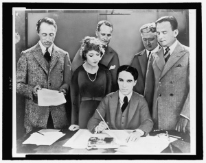 D.W. Griffith, Mary Pickford, Charlie Chaplin (seated) and Douglas Fairbanks at the signing of the contract establishing United Artists motion picture studio (LOC)